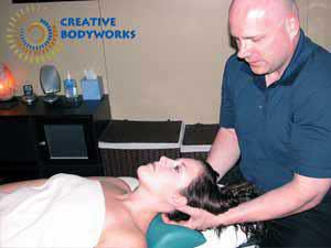 Example of giving a massage to a woman massage by Joel Rayburn LMT a Male Massage Therapist for Creative Bodyworks & Orlando Massage